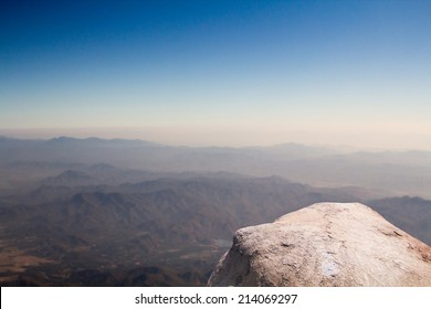 Standing empty on top of a mountain view