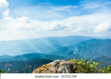 Standing empty on top of a mountain view with sunrays