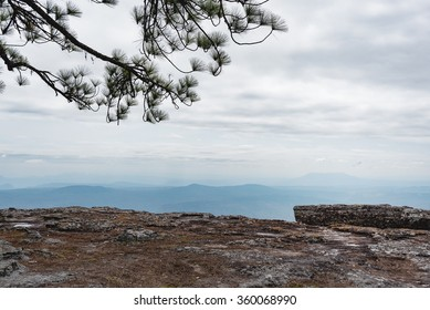 Standing empty on top of a mountain view with clouds before storm at Phu Kradueng National Park, Loei Province, Thailand