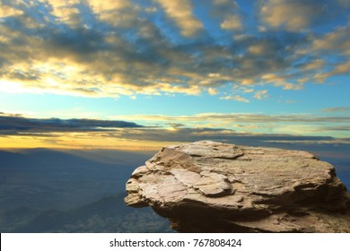 Standing empty on top of a mountain view, Blank space cliff edge with mountain on clouds blue sky
