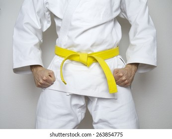 standing fighter yellow belt centered martial arts white suit