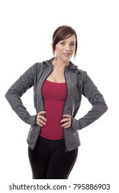 standing fitness woman wearing a tracksuit looking around