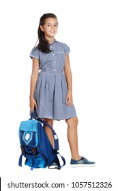 Standing full length picture of a schoolgirl wearing blue  formal dress