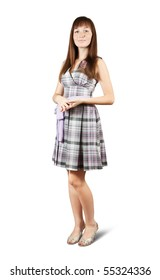 Standing girl in  checked  dress. Isolated with clipping path