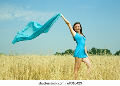 Standing girl  on wheat field in summer