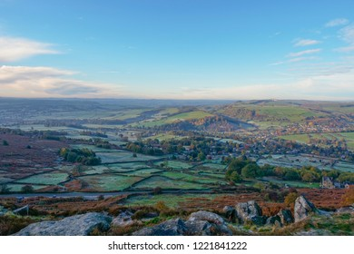 Standing high on Curbar Edge, looking out over a frosty Derbyshire landscape on an autumn morning.