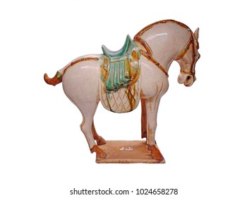 Standing Horse is a Tang dynasty tomb figure. Isolated on white background.