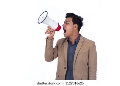 Standing man holding the megaphone shouting over it in a side shot, isolated on a white background.