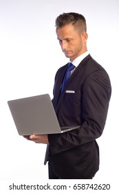 Standing Man in a Suit  holding Laptop