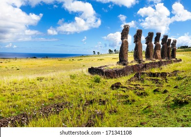 Standing moais looking at sea in Easter Island on sunny day