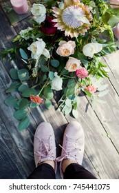 standing near boho flower composition