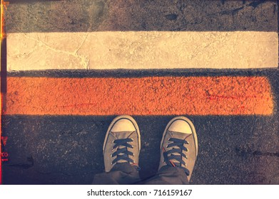 Standing next to street lines. Selective focus