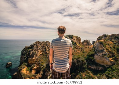 Standing on a cliff looking towards the Atlantic ocean in Lagos, Algarve