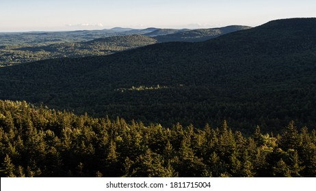 Standing on the edge of the cliff on North Pack Monadnock looking over the mountains of the Wapack Range.