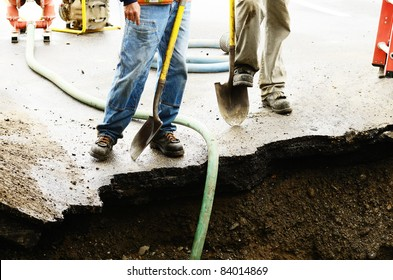 Standing on the edge of a excavation hole to repair a 12 inch water main failure on Harvard Ave in Roseburg OR