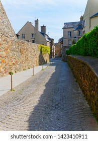 Standing on the quite, narrow cobbled streets of Granville, France.