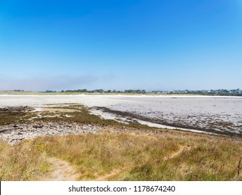 Standing on a small island at low tide looking back at Plage Sainte-Marguerite