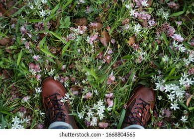 standing on the spring field with boots