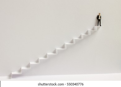 Standing on top of the ladder - success and achievement concept