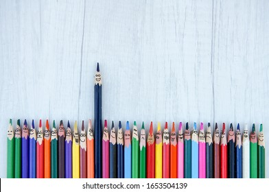Standing out from others concept. Funny pencil with happy expression face is a leader and take leading position concept. Be yourself, be different concept. Think another than others. Creative art back
