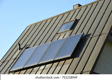 Standing Seam Copper plated Roof with Solar Power, Roof Window and Chimney