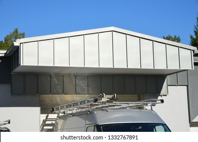 Standing seam Metal Canopy above a loading Platform above a Factory Hall