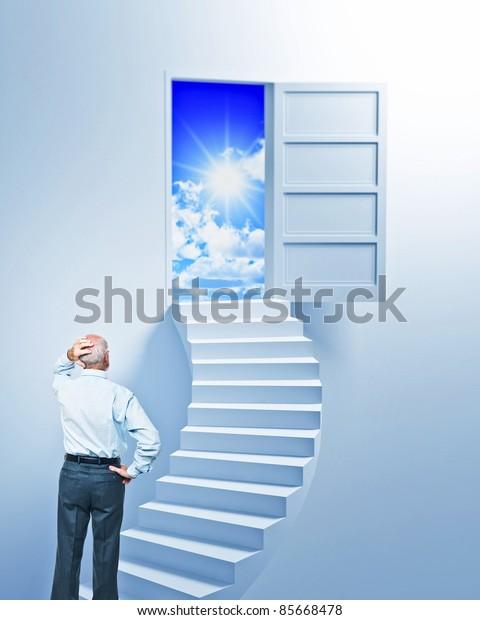 standing senior look open door at the end of stair