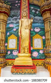 Standing statue of Buddha in Phuket, Thailand. Vertical composition