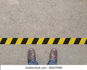 standing at the yellow-black line. Do not cross the line. It's prohibited and not allowed. It's limited. It's the end.