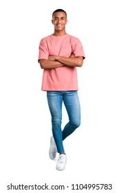 Standing young african american man keeping the arms crossed in frontal position. Confident expression on isolated white background