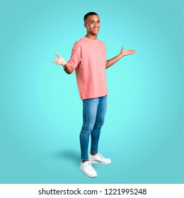 Standing young african american man proud and self-satisfied in love yourself concept on colorful background