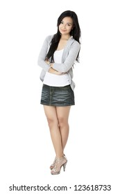 Standing young asian woman with arm crossed