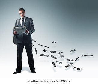 standing young businessman with newspaper and falling words
