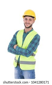 A standing young engineer with crossed arms wearing a reflector-vest and helmet, isolated on a white background.