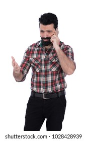 a standing young man looking angry talking on the phone shouting, isolated on a white background.