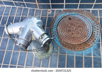 standpipe and manhole cover in blue