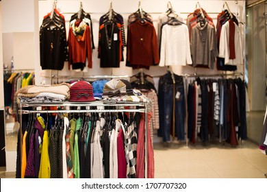 Stands and hangers with goods in a clothing store.