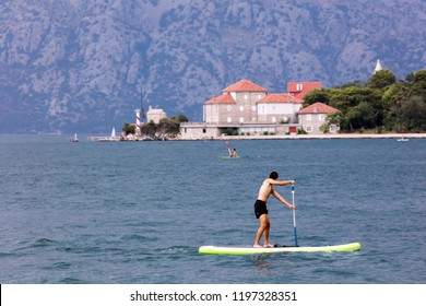 Standup paddle boarding in the Bay of Kotor, Montenegro
