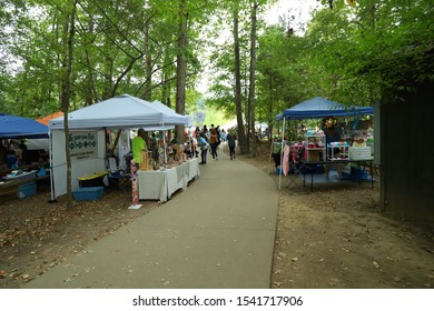 Stanfield,North carolina/United States-9/6/2019: Arts and craft festival in the woods with lots of trees. venders scattered everywhere.
