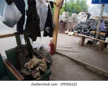 STANITSA LUHANSKAYA, LUHANSK REGION, UKRAINE - June 17, 2014: In a makeshift tent pro-Russian insurgents not only lunch, but keep weapons checkpoint on the old bridge in Stanitsa Luhanskaya.