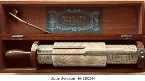 Stanley Fuller calculator slide rule of mahogany, paper and brass dated in 1919. Private Collection, Florida, February, 9, 2020