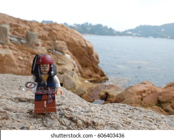 Stanley, Hong Kong: 9 Mar 2017 - Lego Captain Jack Sparrow walking on the shore with his compass. this mini figure is from Pirates of the Caribbean sets. Lego is a brick brand by Lego group