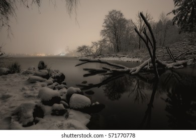 Stanley Park lake covered in snow, Lost Lagoon, during a cold winter night. Picture taken in Vancouver Downtown, British Columbia, Canada, during a big snowfall in the lower mainland.