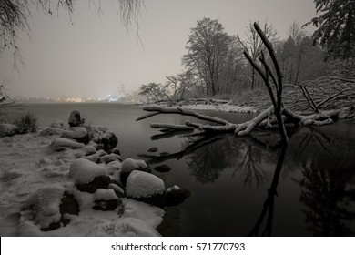 Stanley Park lake, Lost Lagoon, covered in snow during a cold winter night. Picture taken in Vancouver Downtown, British Columbia, Canada, during a big snowfall in the lower mainland.