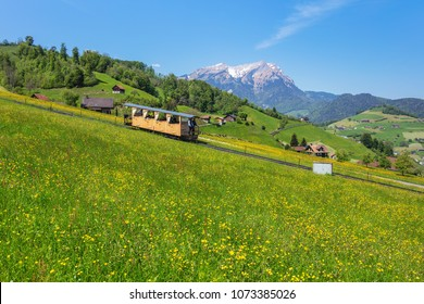 Stans, Switzerland - 8 May, 2016: people in a car of the Stanserhorn funicular railroad heading to the Mt. Stanserhorn. The Stanserhorn is a mountain in the Swiss canton of Nidwalden.