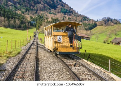 STANS, SWITZERLAND - APRIL 14, 2018: people in the railcar of the Stanserhornbahn funicular railway heading upwards. Stanserhornbahn is a funicular railway from the town of Stans to Mt. Stanserhorn.