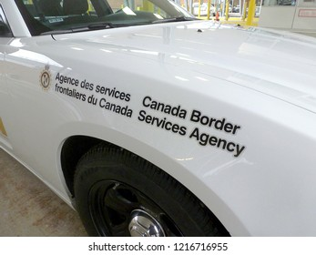 Stanstead, Quebec/Canada - December 5, 2012:   Official patrol car parked at crossing station on the Canada–United States border, connecting the towns of Stanstead, Quebec and Derby Line, Vermont.
