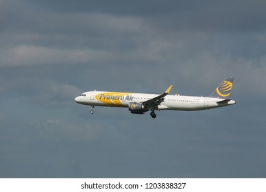 Stansted airport / UK - May 10th, 2018 - Primera Air Airbus A321neo is approaching Stansted airport.