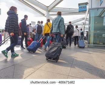 STANSTED, UK - SEPTEMBER 24, 2015: Travellers waiting for tranport at London Stansted airport coach station
