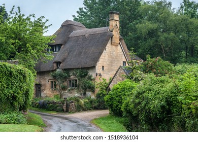 STANTON, ENGLAND - MAY, 26 2018: Thatched cottage in the village of Stanton, Cotswolds district of Gloucestershire.  It's built almost completely of Cotswold stone, a honey-coloured Jurassic limestone